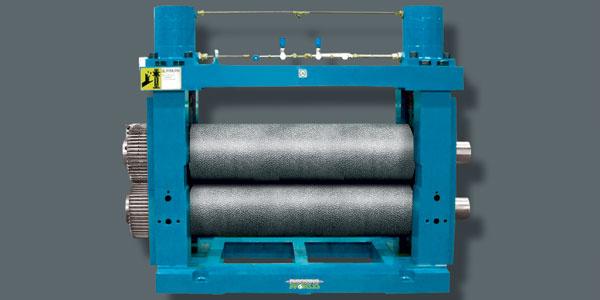 Máquina de gofrado en linea para papel, plástico, papel de aluminio y acero de Embossing World.